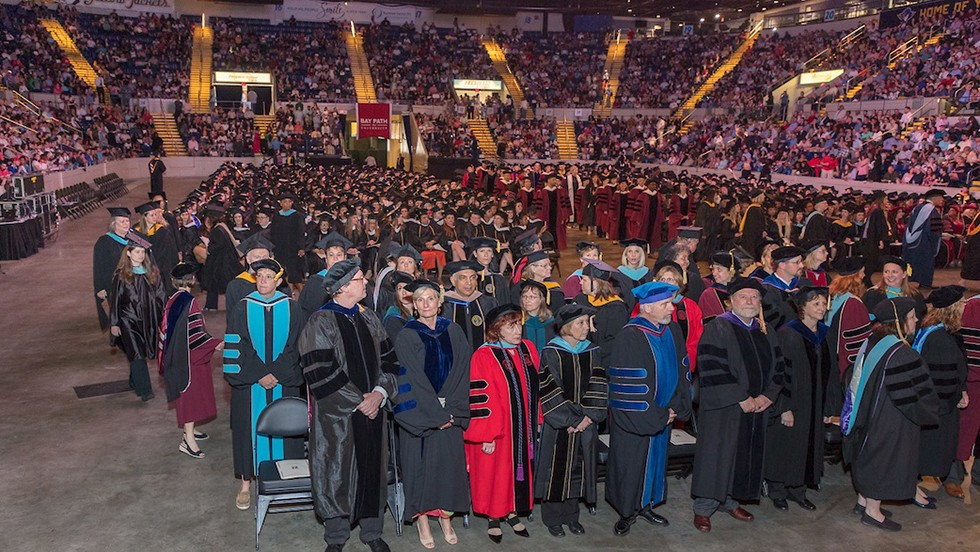 photo of faculty and graduates during Commencement 2019