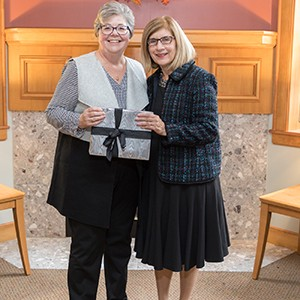 Leslie Scheer '75  pictured with Bay Path President Dr. Carol A. Leary