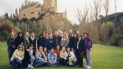 Photo of participants in Bay Path University's Capital of the World trip with a castle in the background
