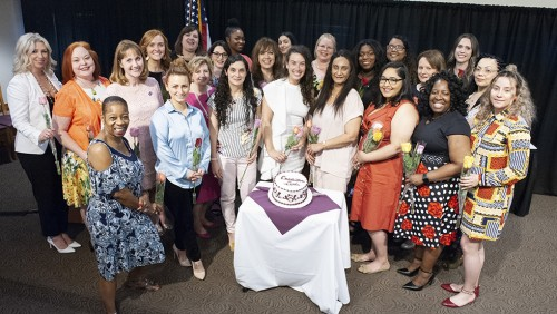 Members of The American Women's College, Class of 2019 pose at the Rose Ceremony, an annual graduation tradition.