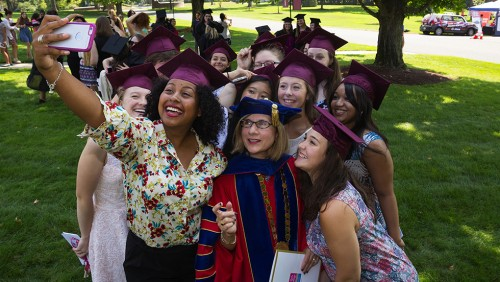 photo of Bay Path students taking a selfie with President Carol Leary